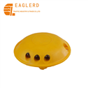 Yellow plastic round road stud with cat eye