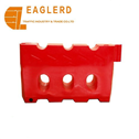 Durable red and yellow plastic traffic barrier for roadway safety